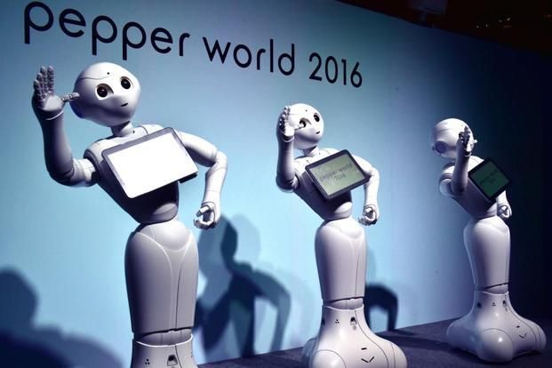 "A file photo of  ""Pepper"", humanoid robots from Japan's Softbank.  Robot-obsessed Japan has repeatedly turned to automated workers to fill labour shortages that are projected to get worse as the country rapidly ages. Photo: AFP"