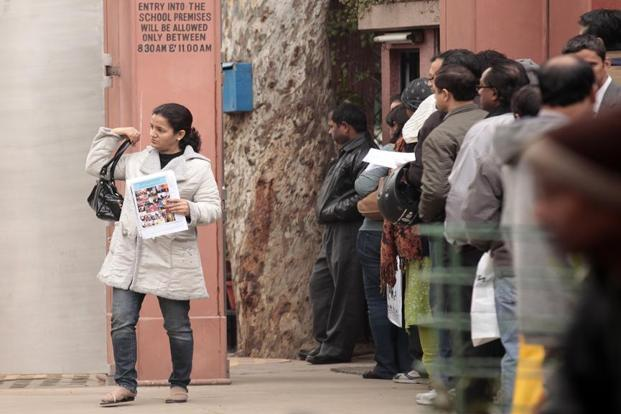 Parents seeking nursery admission forms for their wards wait outside Tagore International school, New Delhi.  Photo: HT