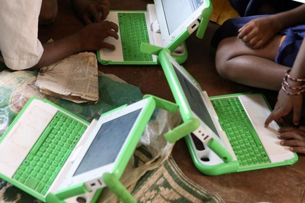 Students work on their One Laptop per Child (OLPC) laptop at Vasti Vidhalaya- a Marathi medium school at Karjat district in Mahrashtra. Photo: AFP