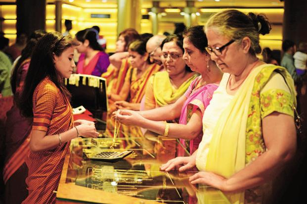 Gold Soars on Market Turbulence, Falling Rates