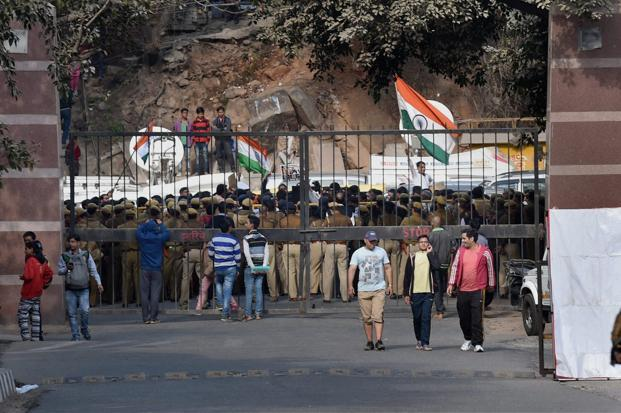 Police personnel at the entrance of JNU as students agitate for the release of the Students Union president Kanhaiya Kumar at the Jawaharlal Nehru University in New Delhi on Monday. Photo: PTI
