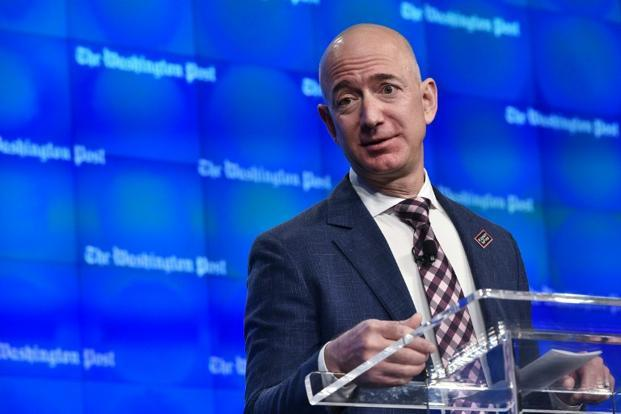 A file photo of Jeff Bezos. Bezos is piling up his chips while counting aloud, so his opponents can watch and hear clearly. Photo: AFP