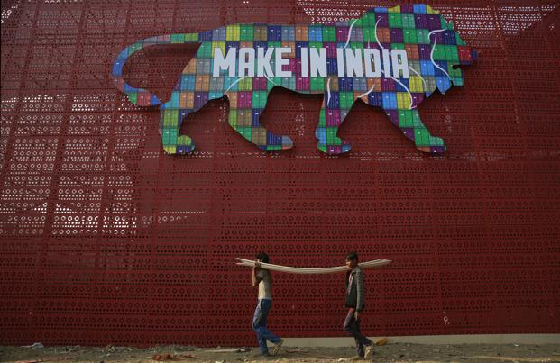 The major objectives behind the Make in India initiative are job creation and skill enhancement in 25 sectors of the economy. Photo: AP