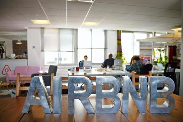 A file photo shows employees working in an Airbnb office in Paris. Photo: AFP