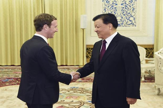 A file photo of Liu Yunshan meeting with Facebook founder and CEO Mark Zuckerberg in Beijing on Saturday. Photo: AP