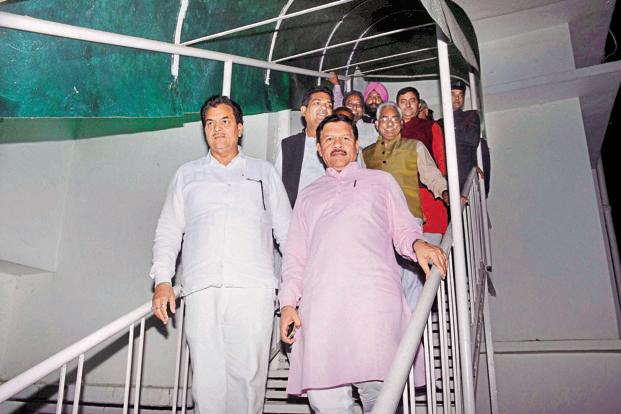 BJP national vice-president Shyam Jaju (right) and rebel Congress legislators step out of Uttarakhand governor K.K. Paul's residence in Dehradun after a meeting on Friday. Photo: PTI