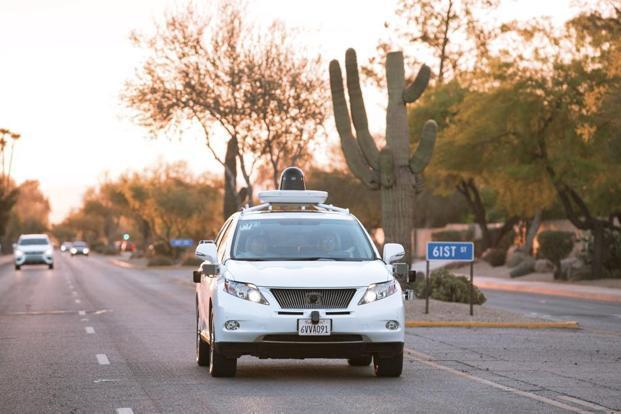 Test drivers use a Lexus SUV, built as a self-driving car, to map the area prior to a journey without a driver in control, in Phoenix, Arizona. Photo: Reuters