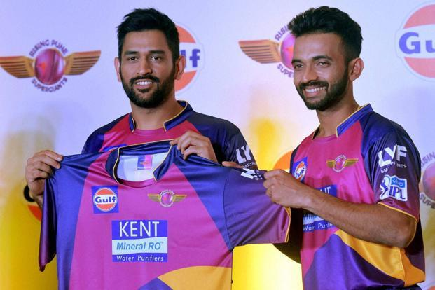 MS Dhoni (left) launches the jersey of his new IPL team Rising Pune Supergiants along with teammate Ajinkya Rahane in Mumbai on Thursday. Photo: PTI