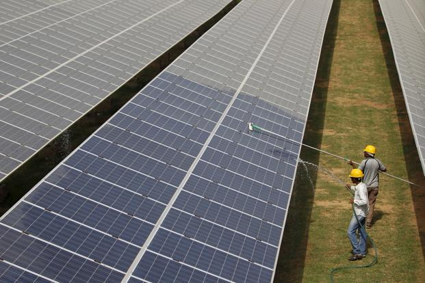 SunEdison, facing potential technical defaults on at least $1.4 billion of loans and credit facilities, is seeking to sell as much as 1 gigawatt of unfinished projects in India. Photo: Reuters