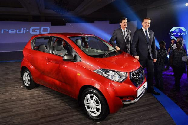 Nissan Motor India, managing director, Arun Malhotra and president, Nissan Motor India Guillaume Sicard pose with New Datsun redi-GO car at its launch in New Delhi on Thursday. Photo: PTI