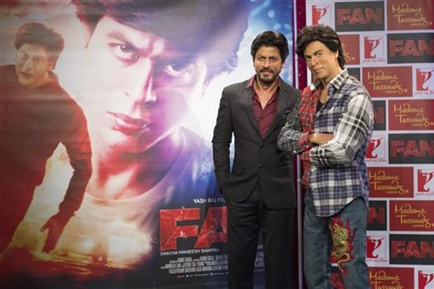 Actor Shah Rukh Khan (left) posed for photographers with his Madame Tussauds wax figure in central London on 13 April. Photo: AFP