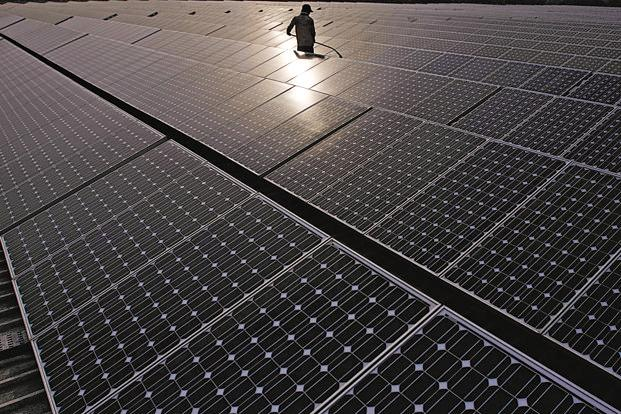 A file photo of a solar power station. Adani has set up an ambitious target to build a capacity of 10,000MW of solar power by 2022. Photo: Bloomberg