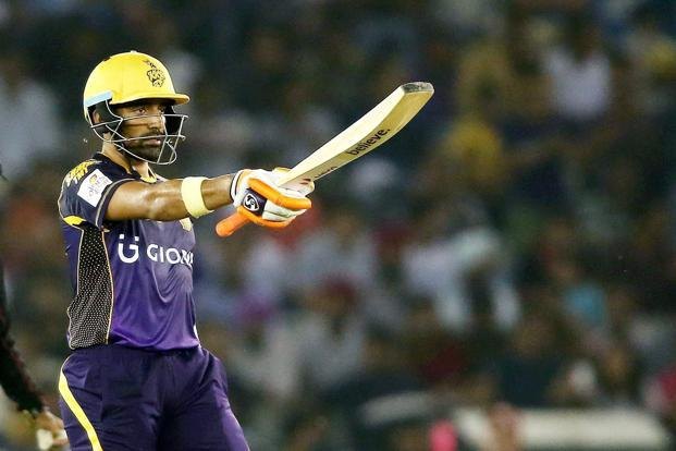 Kolkata Knight Riders batsman Robin Uthappa raises bat after reaching fifty against Kings XI Punjab during the IPL T20 match in Mohali on Tuesday. Photo: PTI