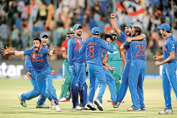 Indian players after defeating Bangladesh by one run in the World Twenty20 cricket tournament in Bengaluru on 23 March. Photo: Reuters