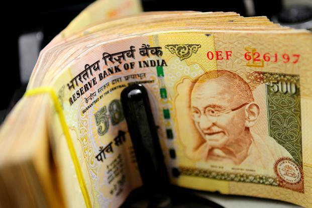 Rupee goes a notch higher against dollar, up 30 paise