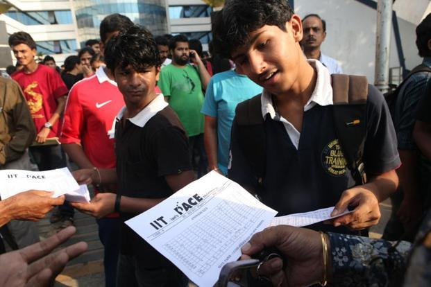 A file photo shows students discussing the question paper after the IIT JEE test. Photo: HT