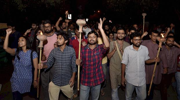 JNUSU President Kanhaiya Kumar with Umar Khalid and other students carried torch parade at JNU campus in New Delhi on Wednesday.  Photo: PTI