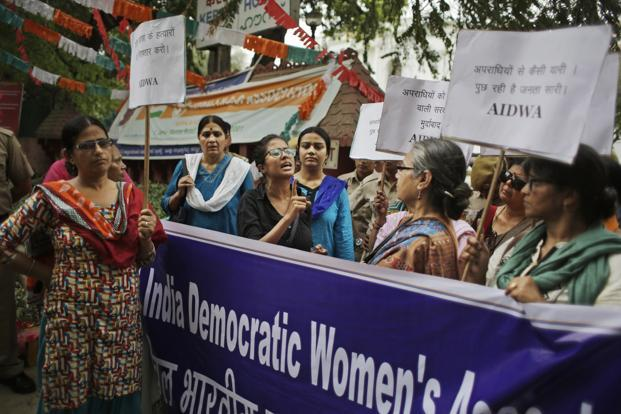 An activist of All India Democratic Women's Association speaks at a protest against the rape and murder of a Dalit woman in Kerala, in New Delhi on Wednesday. Photo: AP