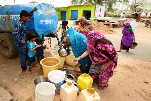 A government tanker supplies potable water in Raipur village, Lalitpur district. More tankers supply water on paper than to villages, say local activists.