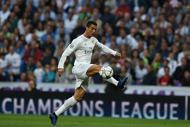 Real Madrid's forward Cristiano Ronaldo controls the ball during the Champions  League semi-final second