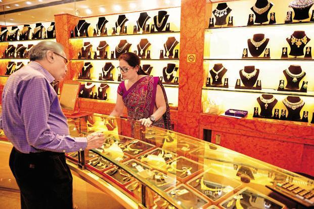 Globally, gold fell 0.41% to $1,271.50 an ounce in Singapore Photo: Pradeep gaur/Mint