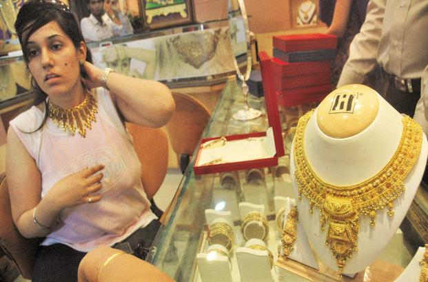 Gold in Singapore, which mostly determines the price trend in Indian market, rose by 0.86% to $1,274.10 an ounce. Photo: AP