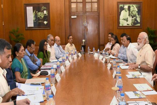 Prime Minister Narendra Modi chairing a high level meeting on drought and water scarcity with the Chief Minister of Gujarat Anandiben Patel. Photo: PTI