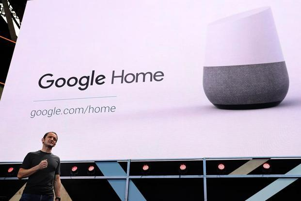 Google vice president of Product Management Mario Queiroz shows the new Google Home, which will sit in living rooms sucking in voice-based queries and delivering verbal answers. Photo: AFP