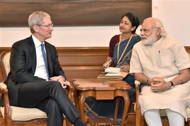 Apple CEO Tim Cook with Prime Minister Narendra Modi in New Delhi on Saturday. Photo: PTI