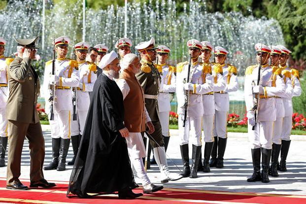 Prime Minister Narendra Modi (centre) with Iranian President Hassan Rouhani during a welcoming ceremony in Tehran on Monday. India and Iran also signed a pact to develop the Chabahar port situated on the Gulf of Oman. Photo: Iranian Presidency Office/AP