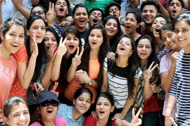 A file photo of students celebrating their success after the announcement of CBSE results. The result will not be available in the board premises and people are advised not to visit its office for collection of results, the official statement said. Photo: PTI
