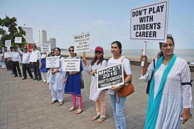 A file photo shows parents of the students preparing for medical entrance exams forming a human chain to protest against the verdict of Supreme Court's on NEET. Photo: AP/PTI