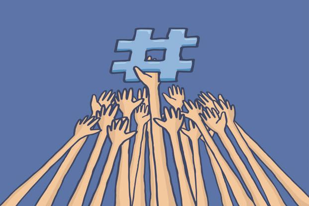Cartoon illustration of arms struggle to reach trending topic hashtag. Photo: Diego Schtutman/iStockphoto
