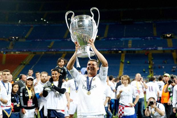 Cristiano Ronaldo Celebrates With The Trophy After Champions League Final Soccer Match Between Real Madrid