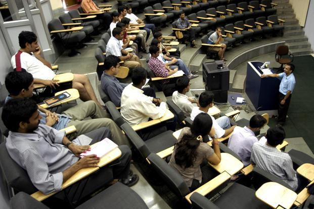 File photo. Professors are of the view that the additional six hours beyond the teaching-learning hours is an excess and may hamper their quality of work. Photo: Bloomberg