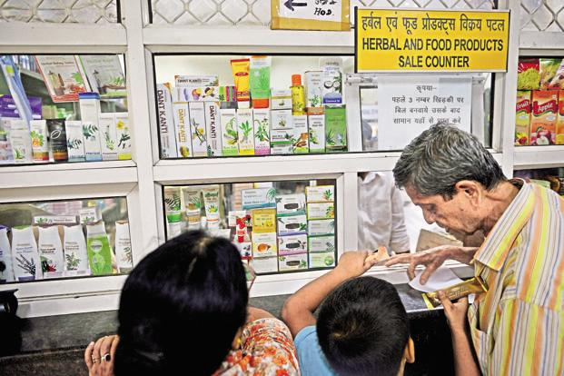 Customers at the sales counter of Patanjali Ayurved's factory in Haridwar.