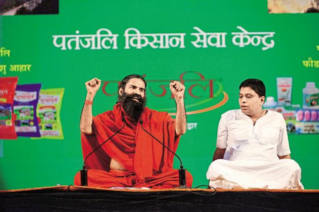 Baba Ramdev with the managing director of Patanjali Ayurved, Acharya Balkrishna.