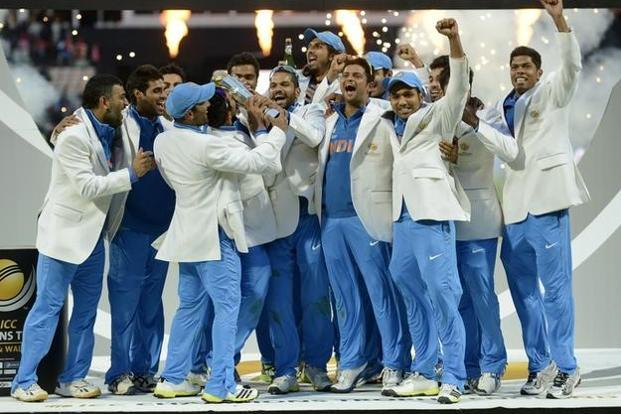 A File Photo Of Indian Team Celebrating With The Trophy After They Won ICC Champions