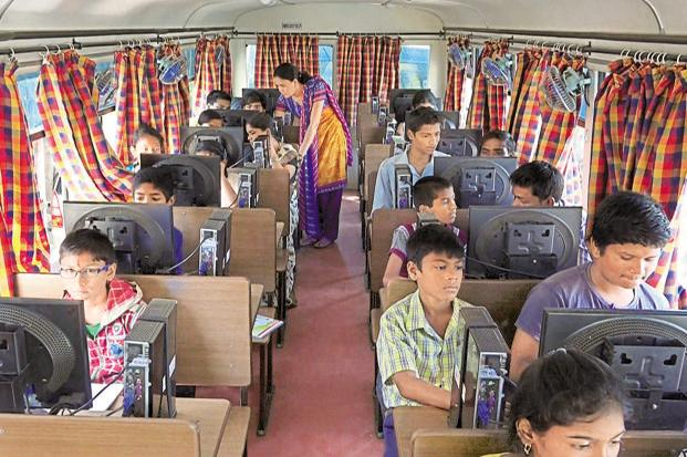 Students inside one of the buses run by the Pune City Connect initiative. Aiming to make Pune city digitally literate by 2020, different IT firms have come together to spread awareness and train citizens.
