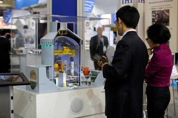 A file photo of visitors looking at a nuclear power plant station model by Westinghouse at an event. Photo: Reuters