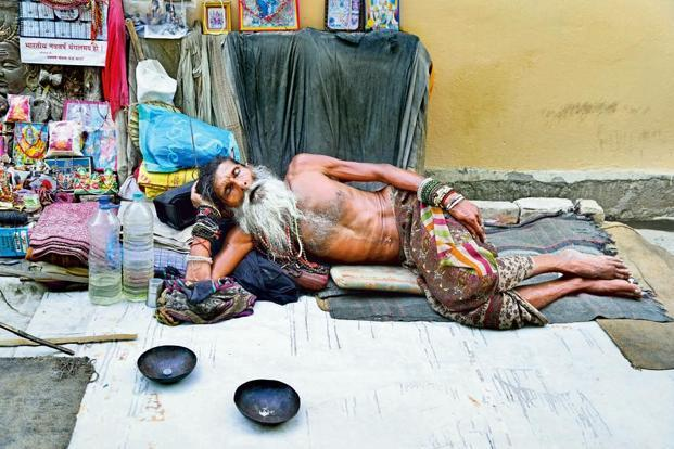 photo essay summer siesta in varanasi livemint a sadhu at assi ghat