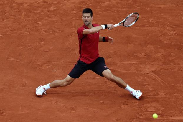Serbia's Novak Djokovic returns the ball to Britain's Andy Murray during their men's final match at the Roland Garros 2016 French Tennis Open in Paris. Photo: Thomas Samson/AFP