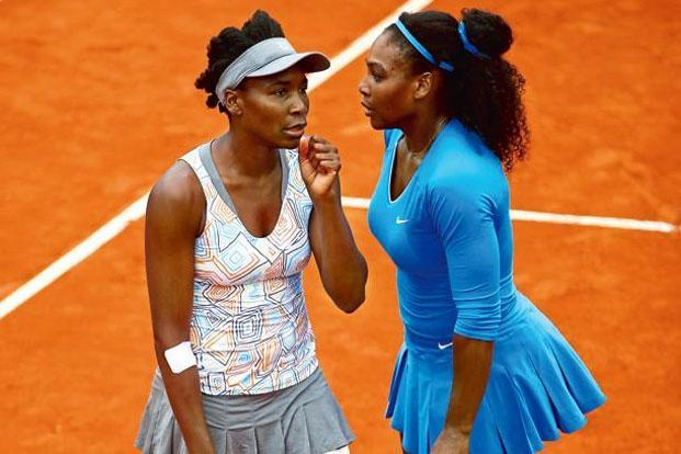 Tennis player sister-duo Serena (right) and Venus Williams. Photo: Clive Brunskill/Getty Images