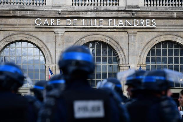 French police stand guard near the main train station as Russia football fans and England football fans (both unseen) gather in the city of Lille, three days after they clashed in the southern French city of Marseille during the Russia vs England group B Euro 2016 match. Photo: Leon Neal/AFP
