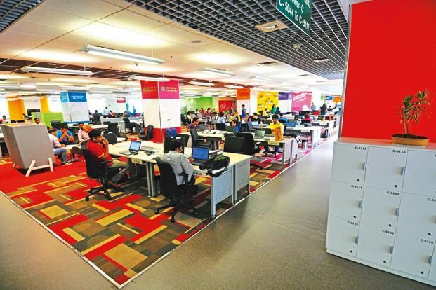 Open-plan workstations, with lockers for storage. Photographs by Priyanka Parashar/Mint