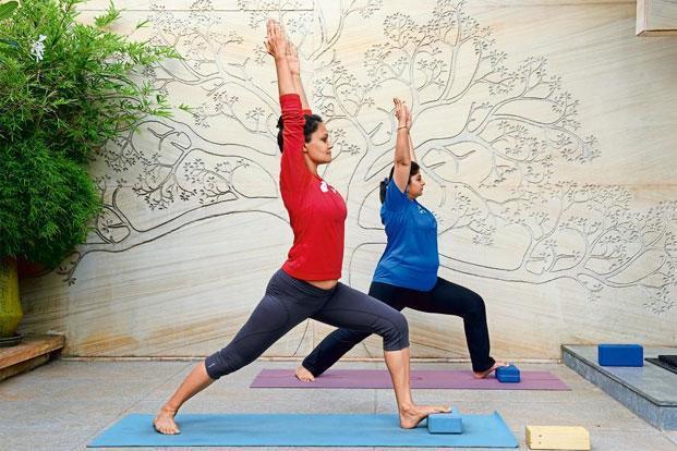 The Iyengar-style yoga: Pragya Bhatt (in red). Photo: Hemant Mishra/Mint
