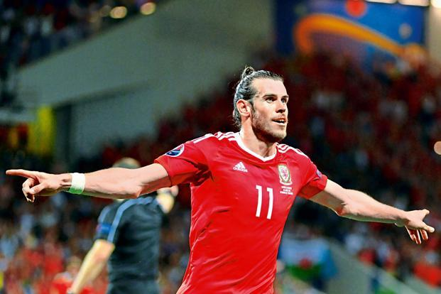 Gareth Bale celebrates Wales' third goal against Russia during Euro Cup 2016. Photo: Pascal Guyot/AFP