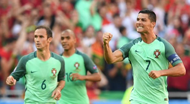 Portugal's forward Cristiano Ronaldo (R) celebrates after scoring a goal during the Euro 2016 group F football match between Hungary and Portugal at the Parc Olympique Lyonnais stadium in Decines-Charpieu, near Lyon. Photo: Francisco Leong/AFP