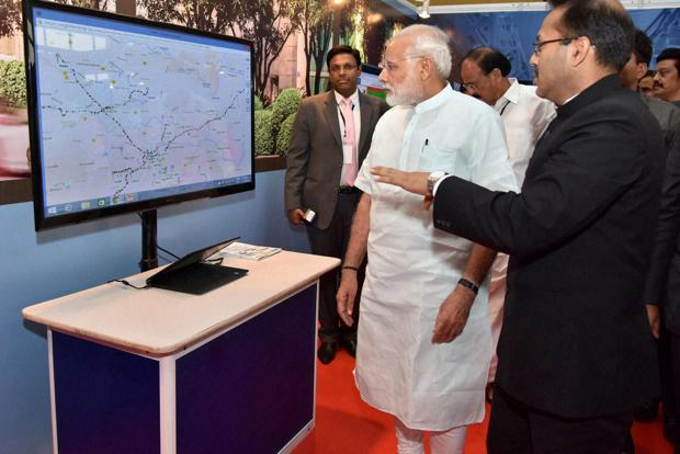 Prime Minister Narendra Modi listening to a demonstration at the Smart Cities exhibition in Pune on Saturday. Photo: PTI