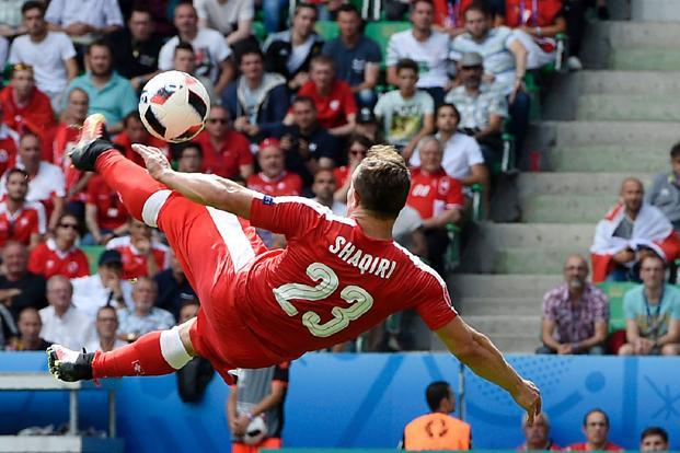Xherdan Shaqiri produced a moment of magic with one of the best goals of the tournament in the 82nd minute, twisting his body in the air to unleash a fierce shot which gave Fabianski no chance as it went in off the post.  Photo: AFP